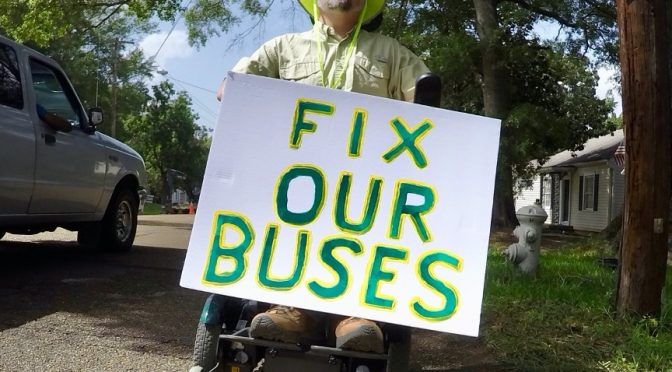 After being left on the side of the road by a broken-down bus in 2016, Scott Crawford of Jackson, Miss., started riding in the street with a sign to raise awareness about accessible public transportation.